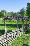 Wooden fences with a stone cairn Royalty Free Stock Image