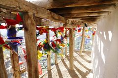 Wooden fencing along balcony with prayer flags, Tsemo monastery, Leh Royalty Free Stock Photography