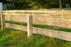 Wooden fencing in the meadow stock image
