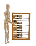 Wooden Figure And Old Wooden Abacus Royalty Free Stock Image