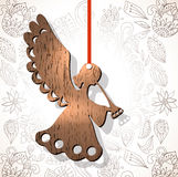 Wooden figure of angel. Over floral background, Christmas decoration Royalty Free Stock Photography