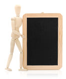 Wooden figure and chalkboard Stock Photography