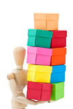 Wooden figure colored boxes Royalty Free Stock Images