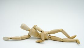 Wooden figure concepts. Various poses of wooden manikin Stock Photos