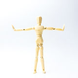Wooden figure doll with extend the arms emotion for exercise con Royalty Free Stock Image