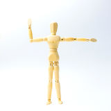 Wooden figure doll with extend the arms emotion for exercise con. Cept on white background Stock Image