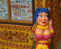 Wooden figure of a gypsy, wood carving decoration in the souvenir shop Stock Photo