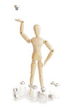 Wooden figure holding medicine injector Stock Photos