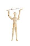 Wooden figure holding medicine injector Stock Photos