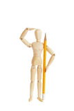 Wooden figure holding pencil and looking Stock Photography