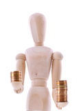 The wooden figure holds coins Stock Images