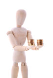 The wooden figure holds coins Stock Photography