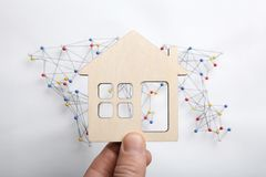 Wooden figure of house on world map royalty free stock photography