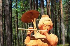 A wooden figure of a Japanese woman royalty free stock image