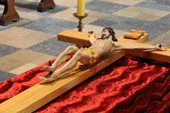 Wooden figure of Jesus crucified, in the church during Easter Stock Photography