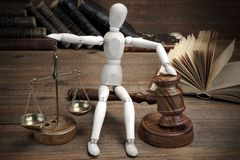 Wooden Figure With Judges Gavel And Scale Of Justice Stock Photo