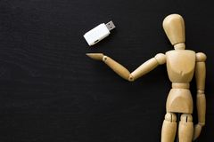 Wooden Figure Manikin Human Artist Draw Painting wood doll. Holding a pen drive stock photography