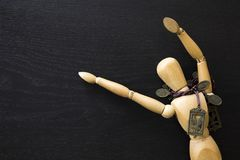 Wooden Figure Manikin Human Artist Draw Painting wood doll. Happy jumping with necklace stock image