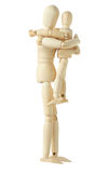 Wooden figure of parent holding child Royalty Free Stock Image