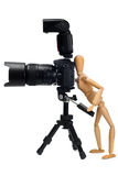 The wooden figure of photographer Stock Photo