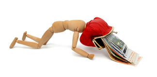 Wooden figure with a purse and euro. Royalty Free Stock Photography