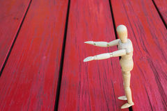 Wooden figure raising arm / hand and introduce Stock Photos