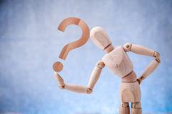 Wooden figure showing question mark symbol Stock Images