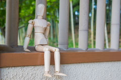 Wooden figure sitting on architrave window. And selective focus royalty free illustration