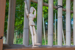 Wooden figure standing. On architrave window and selective focus stock illustration