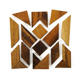 Wooden figures assemble in square puzzle. Isolated royalty free stock image