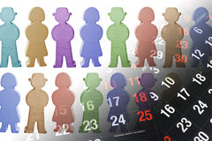 Wooden Figures and Calendar Pages Stock Photo