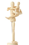 Wooden figures of child embracing his parent Royalty Free Stock Photo