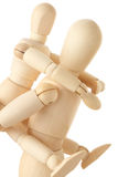 Wooden figures of child sitting on back of parent Royalty Free Stock Photography