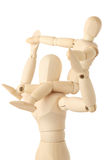 Wooden figures of child sitting on neck of parent Stock Image