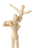 Wooden figures of child sitting on neck of parent Stock Photos
