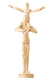 Wooden figures of child sitting on neck of parent Royalty Free Stock Photos