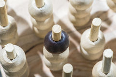 Wooden figures in the concept of individuality Royalty Free Stock Image