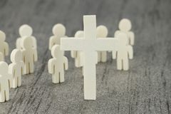 Wooden Figures with cross symbol Royalty Free Stock Image