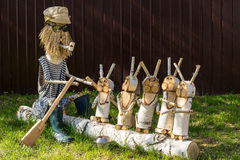 Wooden figures depicting characters of Russian fairy tales.Grandfather Mazzei and hares Stock Image