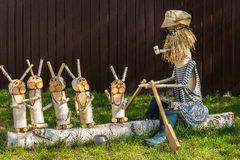 Wooden figures depicting characters of Russian fairy tales.Grandfather Mazzei and hares Royalty Free Stock Photography