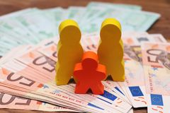 Family figures with money euro hundred royalty free stock image