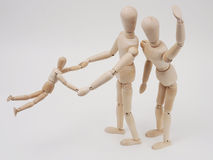 Wooden figures of family Stock Image