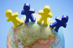 Wooden Figures on Globe Stock Images
