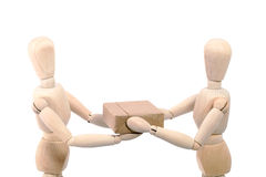 Wooden figures holding box Stock Photo