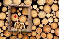 Wooden figures in love stock image