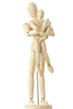 Wooden figures of parent carring child from back. Wooden figures of parent carring his child from back, full body, isolated on white Royalty Free Stock Photography