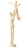 Wooden figures of parent carring child over head Royalty Free Stock Photo