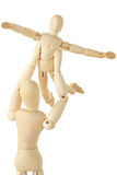 Wooden figures of parent carring child over head Stock Image