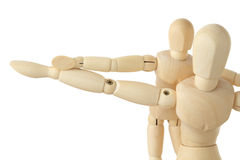 Wooden figures parent and child, hands apart Stock Image