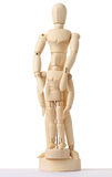 Wooden figures of parent embracing child Royalty Free Stock Photo